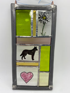 Stained glass panel with dog and flower and heart
