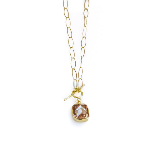Gold, oval loop, chain necklace, with a honey brown colored, emerald cut, stone