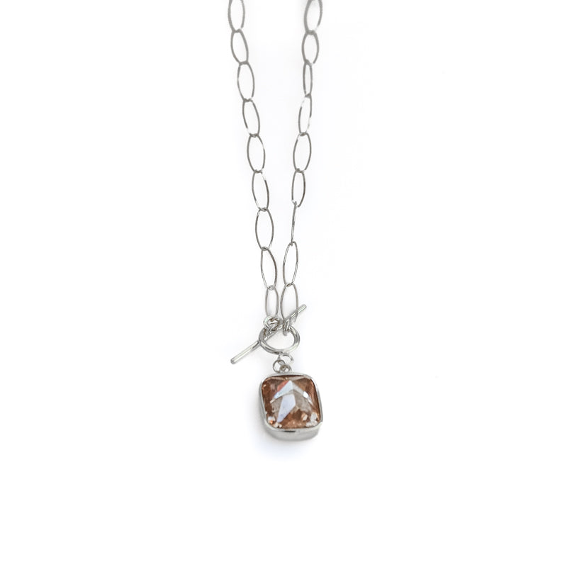 Silver, oval loop, chain necklace, with a light brown colored, emerald cut, zirgon stone