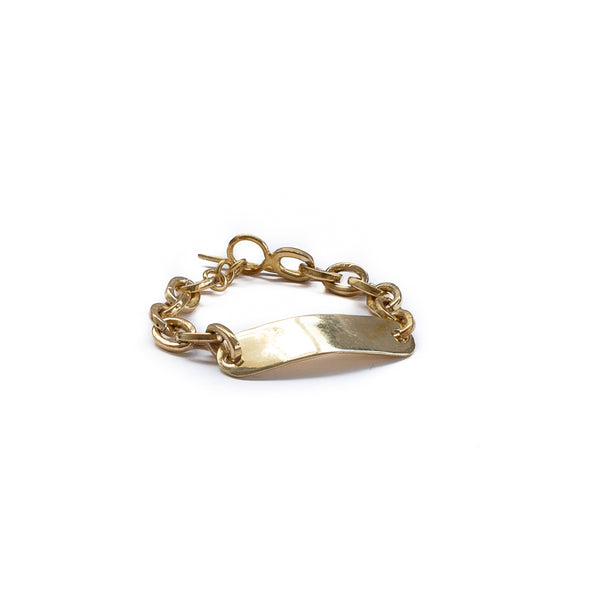 Gold, toggle link, id bracelet, with an oblong plaque. By 3rd Floor Handmade Jewellery
