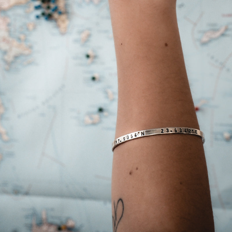 womans arm, with coordinates bracelet memories,silver