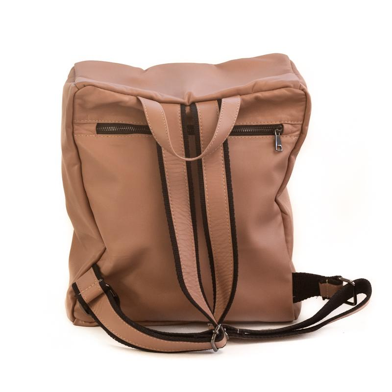 Photo of the back side, of a tan colored backpack