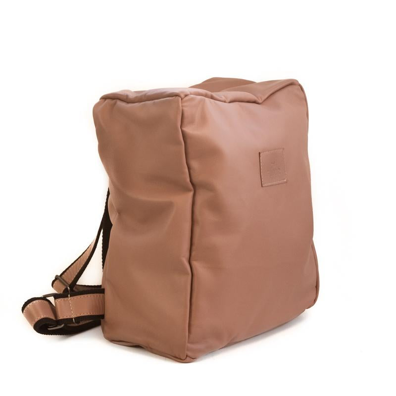 Photo of front side of a ligh- tan colored backpack