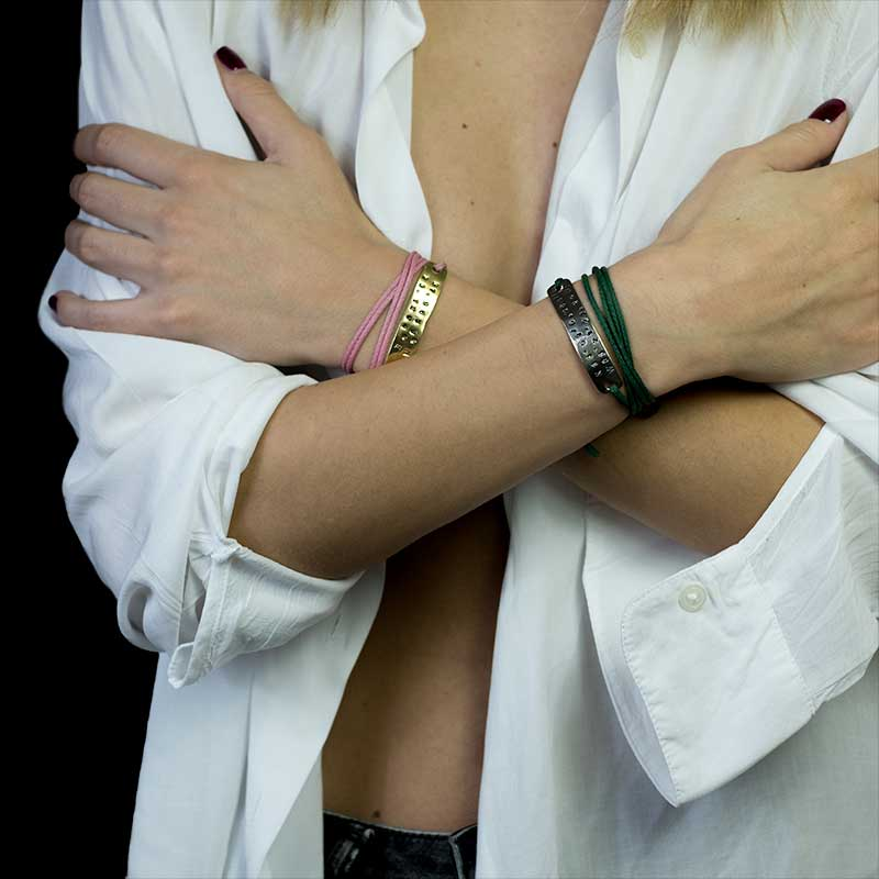 girl's hands crossed over chest open white shirt wearing coordinates stamped bracelets on either wrist