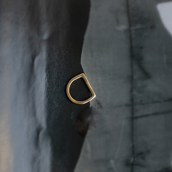 Gold ring with a flat, circular shank and a straight head line. By 3rd Floor Handmade Jewellery