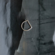 Load image into Gallery viewer, Silver ring with a flat, circular shank and a straight head line, placed on black fabric\. By 3rd Floor Handmade Jewellery