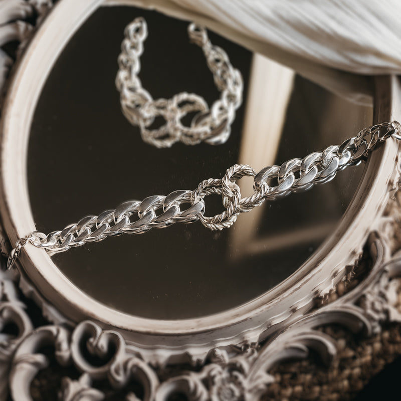 Silver, curb link chain necklace, with a central, interlocking, rope chain