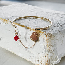 Load image into Gallery viewer, Belamour. Gold, bangle and chain bracelet, with a small, coral cross, and a small heart