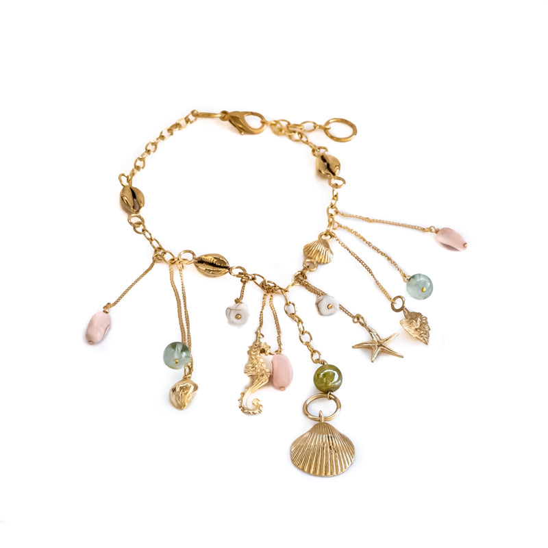 Bailar. Gold charm necklace, with summer charms, and colorful stones. By 3rd Floor Lab