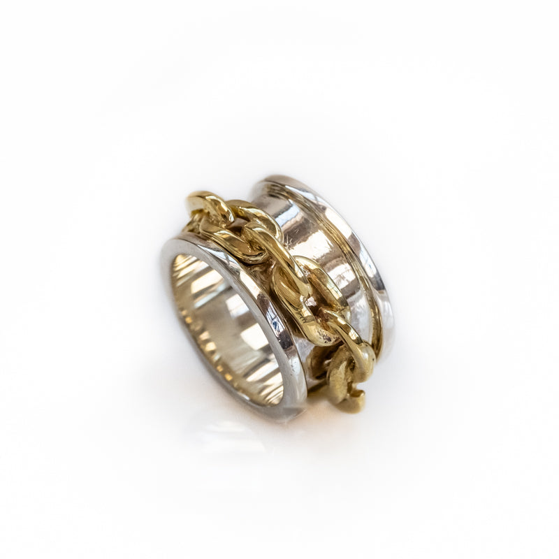 Brazil Traveller. Wide, silver ring, with a loosely fitted, gold link ring on it. By 3rd Floor Handmade Jewellery