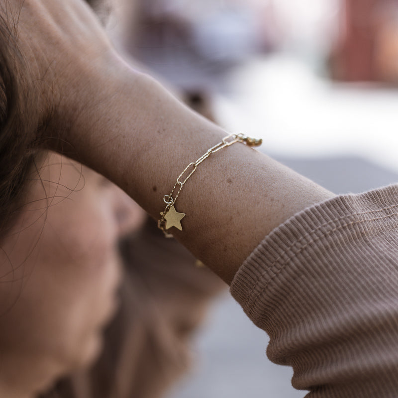 Female's forearm. She is wearing a handmade, gold plated, Solstice bracelet, by 3rd Floor
