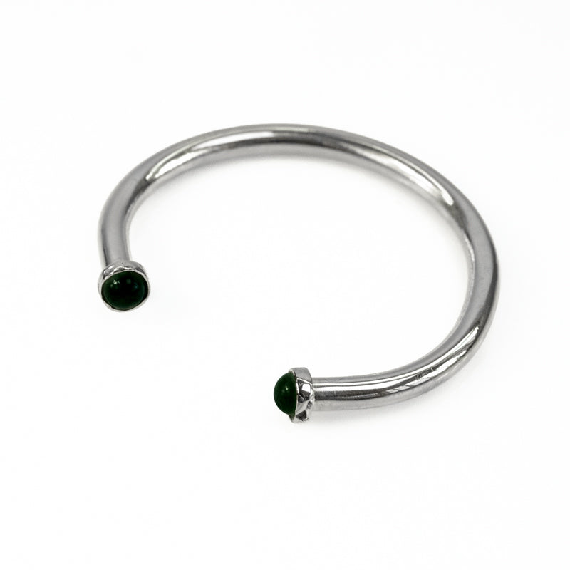 Cosette. Silver, adjustable bracelet, with an encased, black onyx stone, on either end
