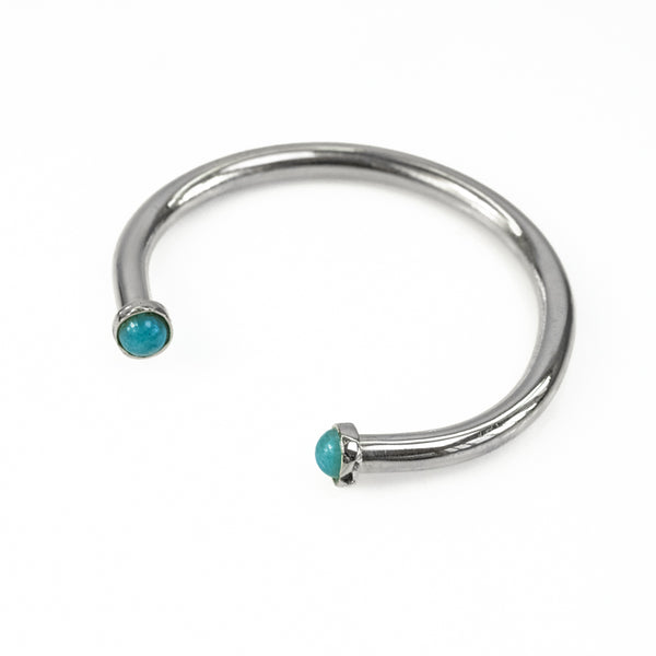 Cosette. Silver, adjustable bracelet, with an encased, turquoise stone, on either end