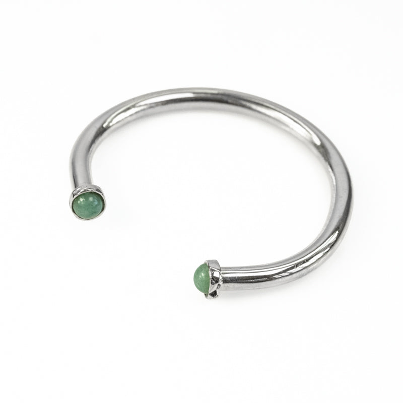 Cosette. Silver, adjustable bracelet, with an encased, green aventurine stone, on either end