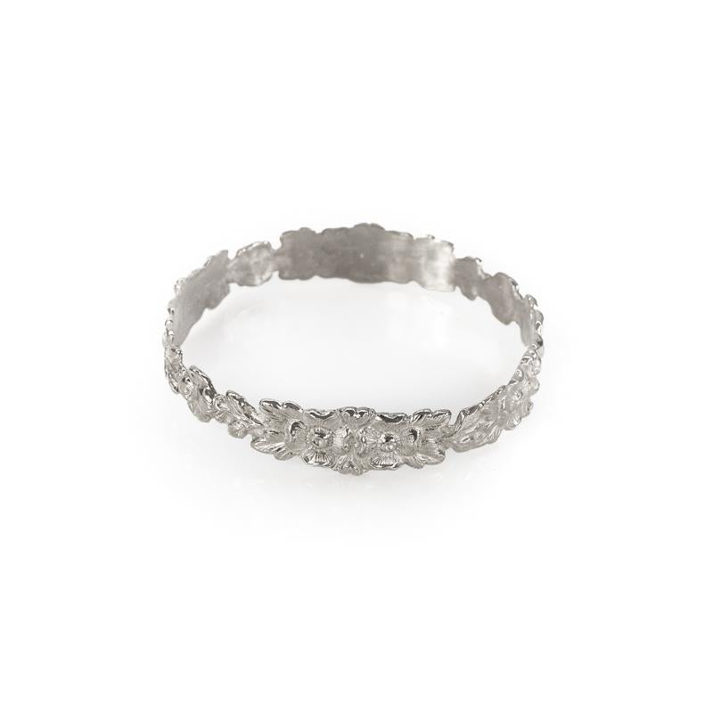 Hippolyta. Silver bangle bracelet, with embossed, intertwined flowers
