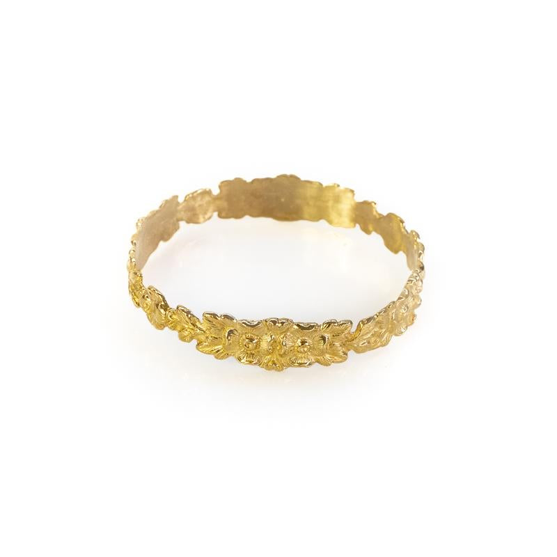 Photo of gold, Hyppolyta bracelet, with embossed, intertwined flowers