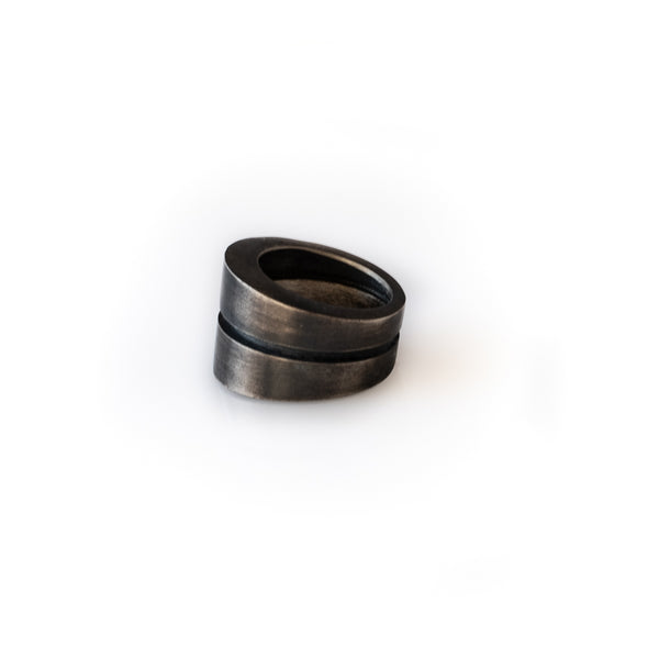 Wide, black ring, with a deep embossed line around its circumference. By 3rd Floor Lab