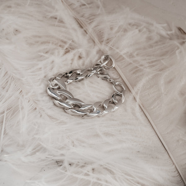 Mangata. Chunky chain bracelet, placed on white feather. By 3rd Floor Handmade Jewellery