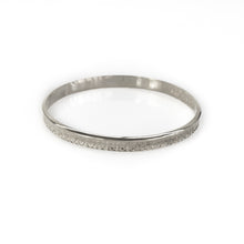 Load image into Gallery viewer, Photo of a silver, rod bracelet, with embossed designs. By 3rd Floor Handmade Jewellery
