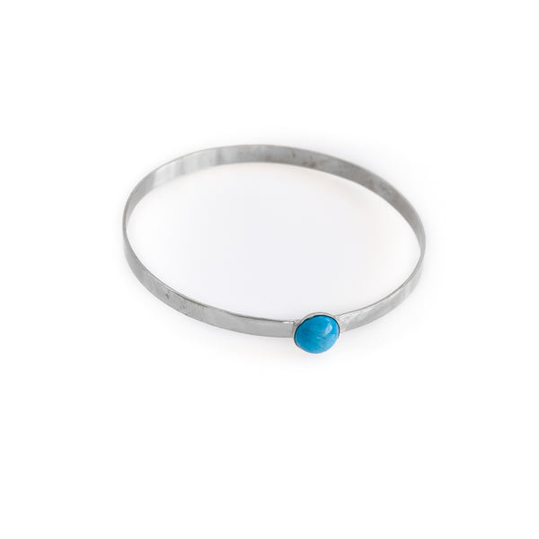 Odette. Silver, flat, bangle bracelet with a turquoise stone. By 3rd Floor Handmade Jewellery
