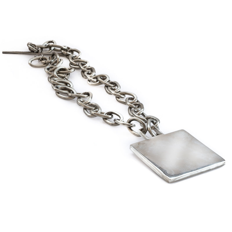 Long, silver, toggle link, chain necklace, with a big, solid, square element.