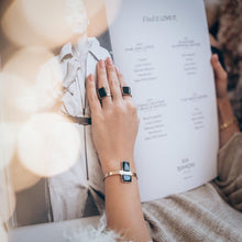 Load image into Gallery viewer, photo of female hand, wearing a handmade, Antidote bracelet and Antidote rings, on her index and wedding ring fingers