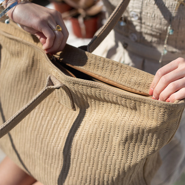 Close up photo of a big, beige, Galena beach bag