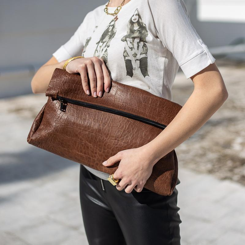 model holding, handmade croco leather bag brown