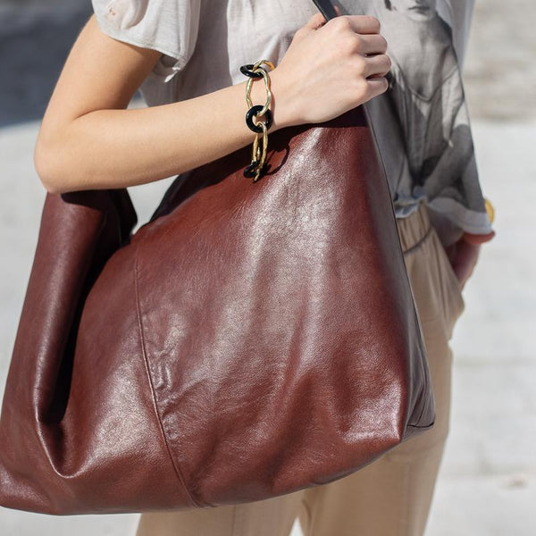 lady holding a Bordeaux kayla, leather bag, with zip, made in greece by 3rd-floor