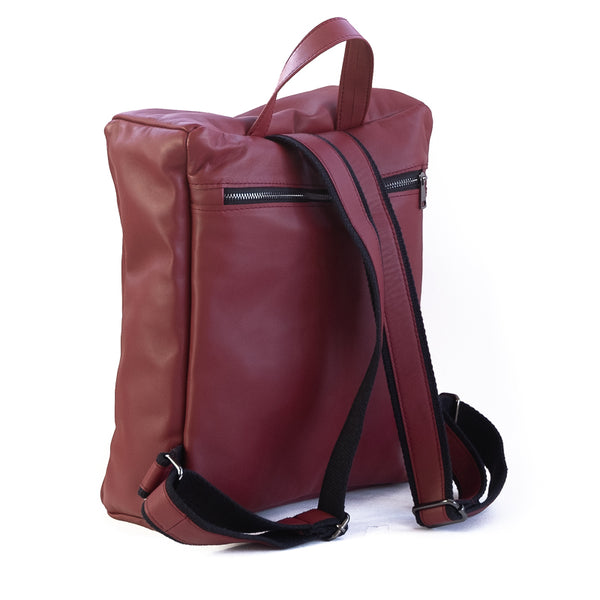 Photo of the back side of a burgundy packpack