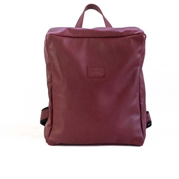 Photo of the front side of a burgundy packpack