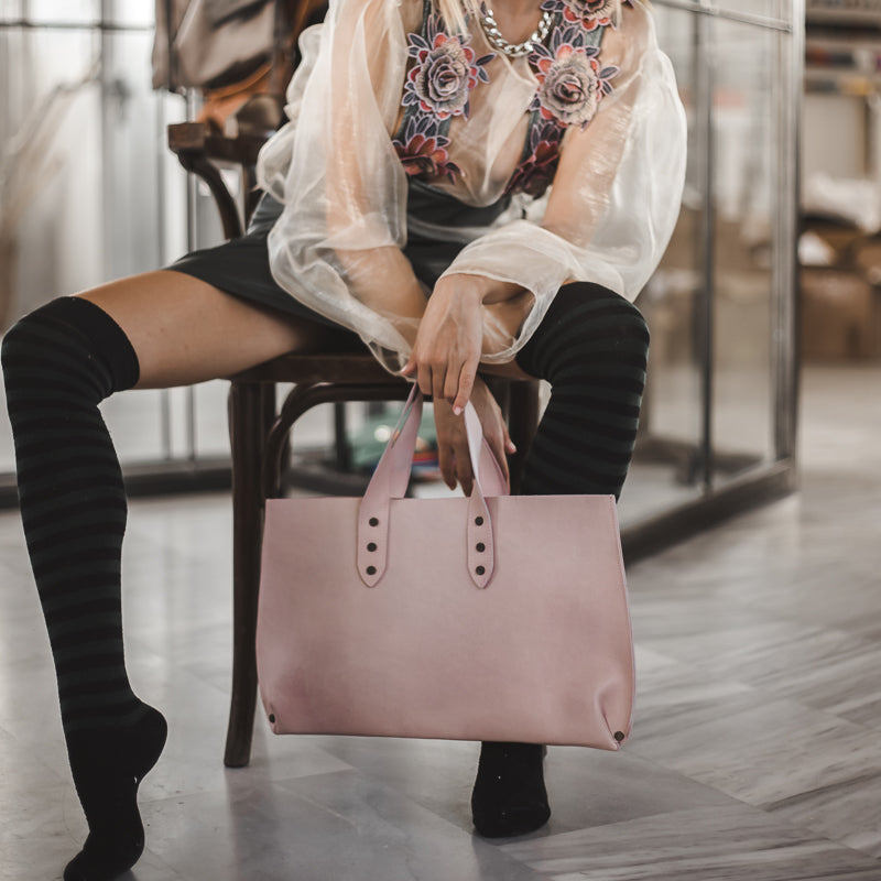girl is holding a dusty pink leather bag mini jet made in greece