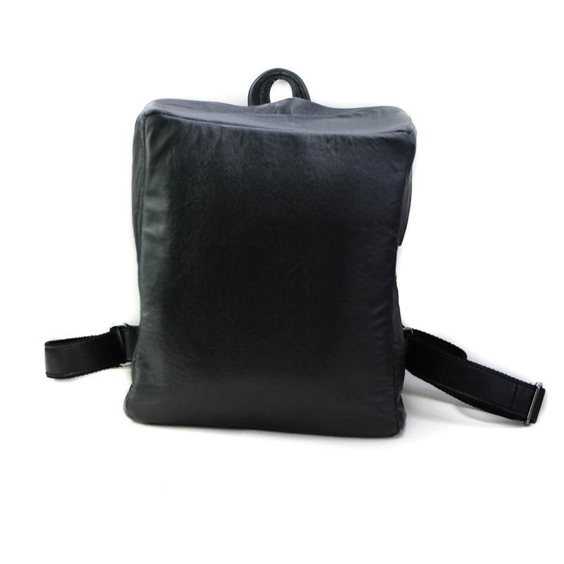 Photo of the front side of a black backpack. By 3rd Floor Handmade Leather Bags