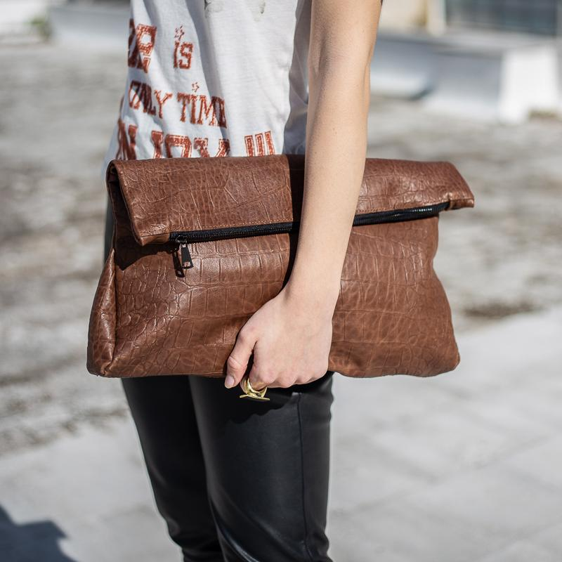 girl holding, handmade croco leather bag brown