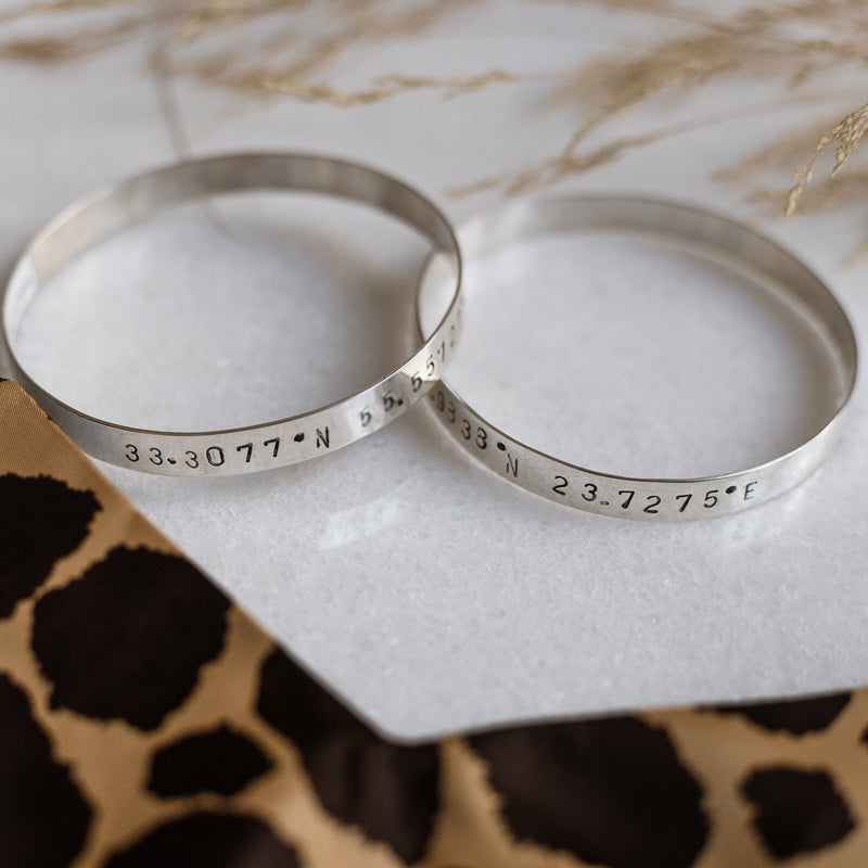 photo of 2 Marco Polo handmade bangle bracelets stamped with your choice of longitude and latitude coordinates - By 3rd Floor