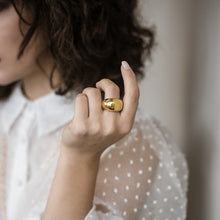 Load image into Gallery viewer, Brunette female in a sheer, white, polka dot blouse. On her left middle finger she is wearing a big, gold ring by 3rd Floor