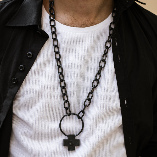 close upman in black shirt wearing,And chain pendant black