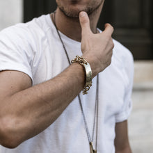 Load image into Gallery viewer, Cropped photo of male in white t-shirt. His right hand, bent towards his face. On it he is wearing gold, chain, bracelets by 3rd Floor