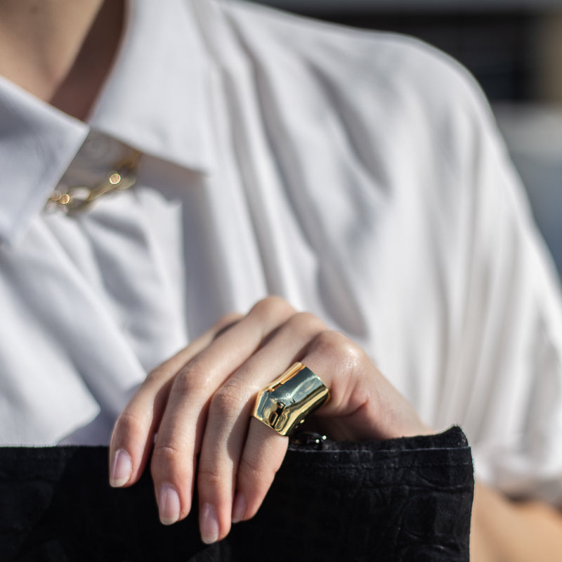 woman in white, wearing punch ring, gold by 3rd-floor