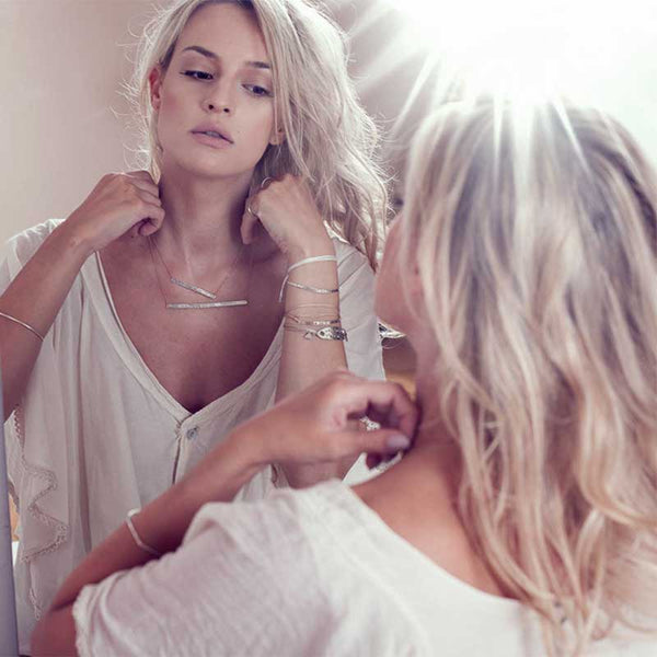 Blond girl reflection in mirror wearing 3rd Floor 925 silver handmade jewellery