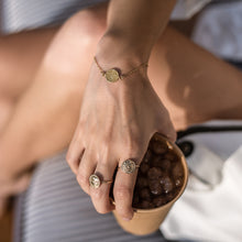 Load image into Gallery viewer, girl with cup of coffee and 3rd floor handmade jewellery faistos ring-gold