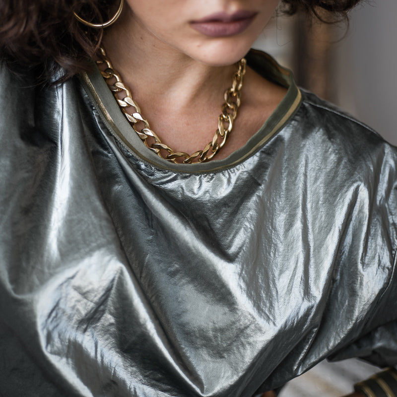 Shot of a woman's head/neck with Bilboe necklace. Handmade in Athens by 3rd Floor Workshop