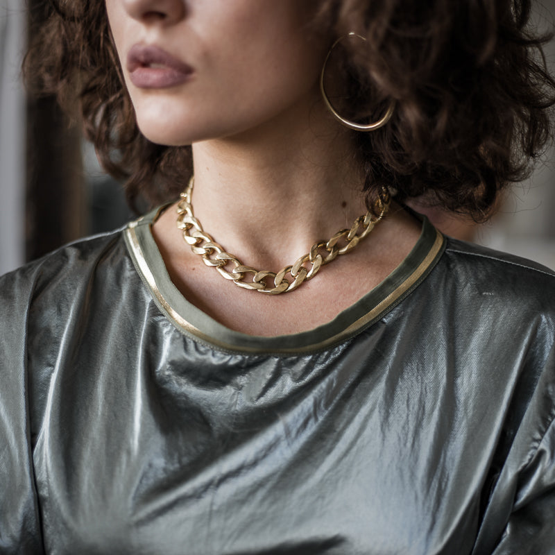Shot of a woman's head/neck with Bilboe gold necklace. Handmade in Athens by 3rd Floor Workshop