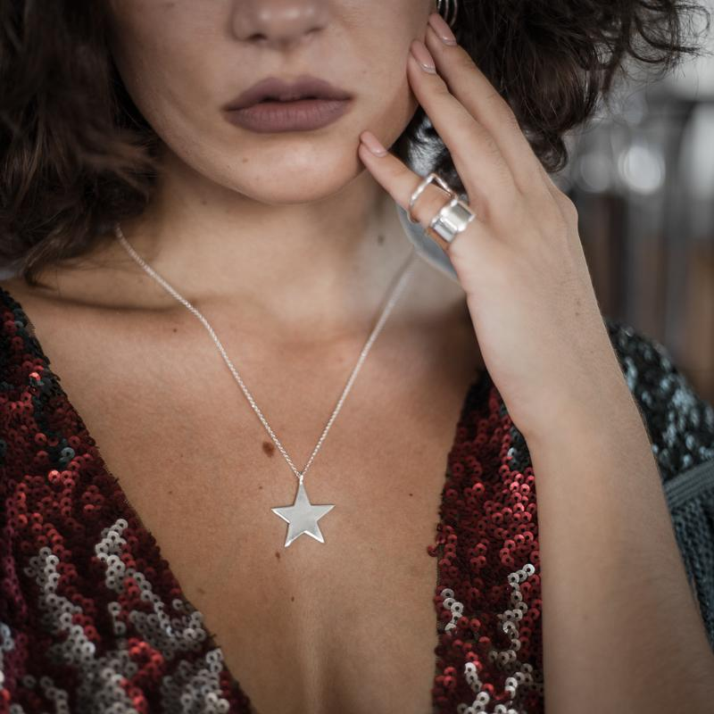 girl holding her face, wearing Vega. Handmade, silver plated 925 silver, star pendant, by 3rd Floor Handmade Jewellery