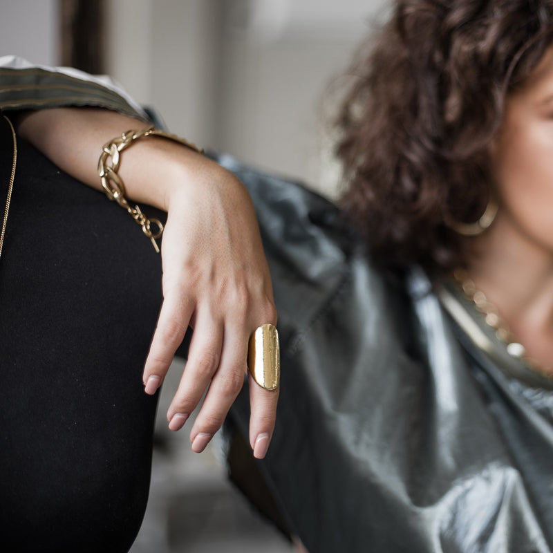 woman with green shirt wearing Cliff ring. Handmade, gold plated silver ring, created in Athens by 3rd Floor Workshop
