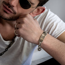 Load image into Gallery viewer, man in white shirt wearing handmade jewellery Grade bracelet silver
