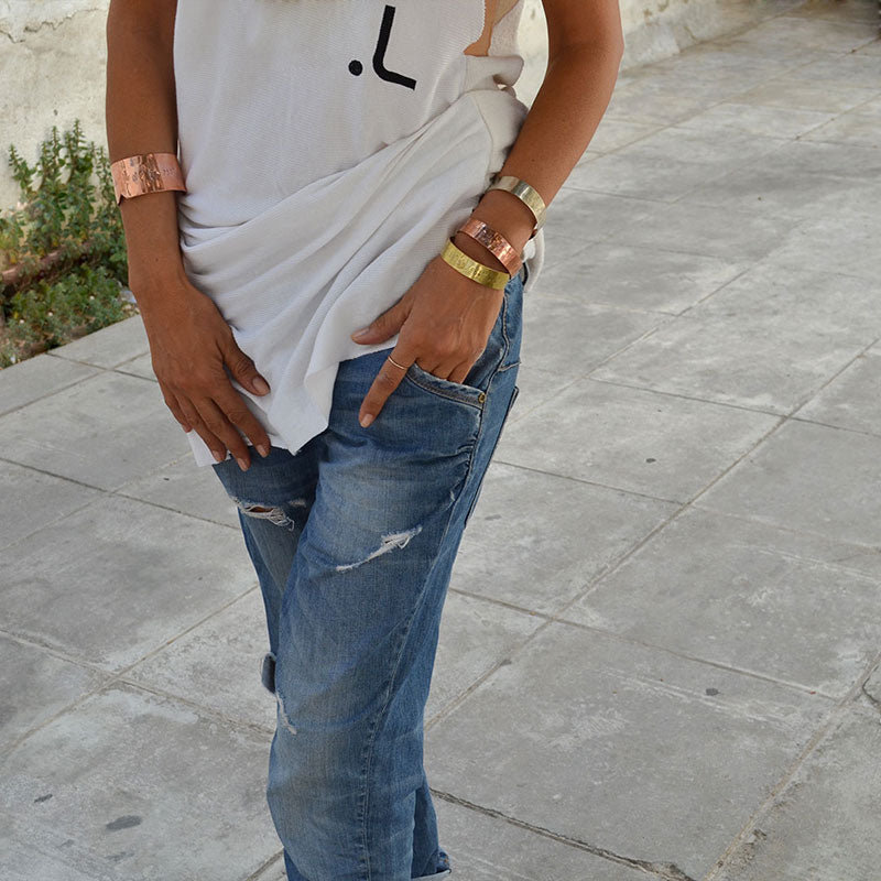 Girl in white tshirt and jeans wearing 3rd floor coordinates bracelets