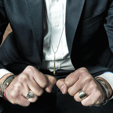 Load image into Gallery viewer, Sitting mand in suit, wearing 3rd Floor Handmade Men's rings