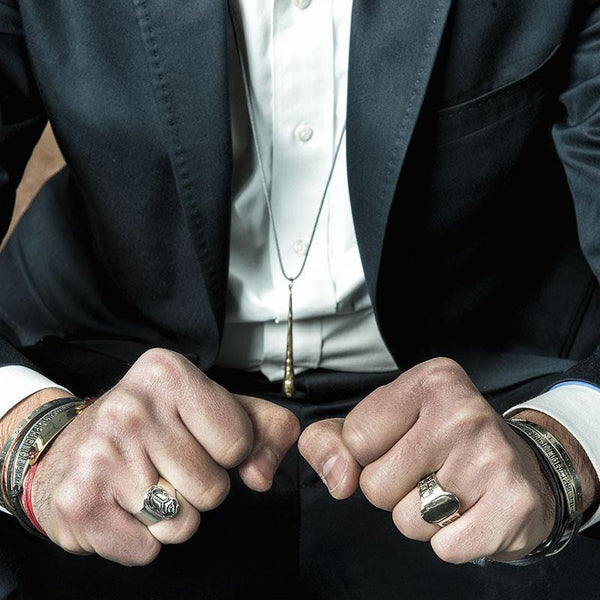 Sitting mand in suit, wearing 3rd Floor Handmade Men's rings