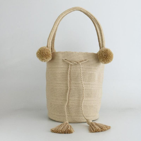 This bag is hand made using weaving techniques has 4 borlas in latte color
